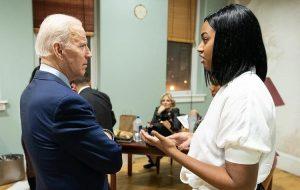 Hill speaks to President Biden.  Photo from Hill.