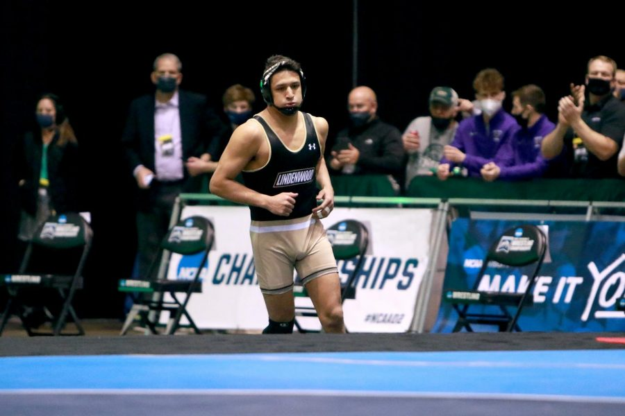 Lindenwood wrestler Abner Romero runs out onto the mat ahead of his match during the 2021 NCAA Division II National Championships from March 12-13.
