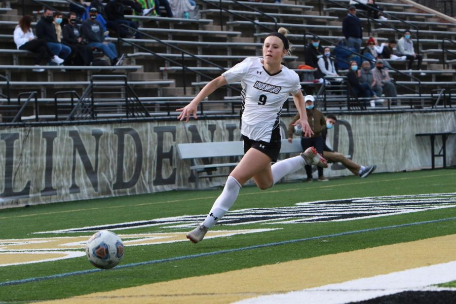 Freshman forward Maggie Weller chases down the ball in front of the home stands at Hunter Stadium during the 2021 season.  Photo provided by Lindenwood Athletics.