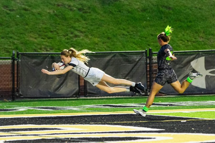 Junior Jessica Laughlin dives in to score to make it 39-12 for the Lions against Life University in the Division I Elite Championship on May 1, 2021.