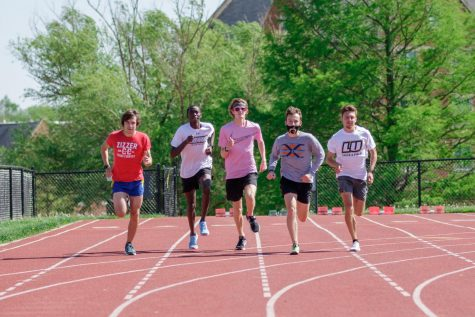 Ben Stasney (left), Edward Kipruto, Timothy Maxwell (middle), Brady Mello, and Louis Moreau (right) run in a group on April 30 during a practice on the Lindenwood track.