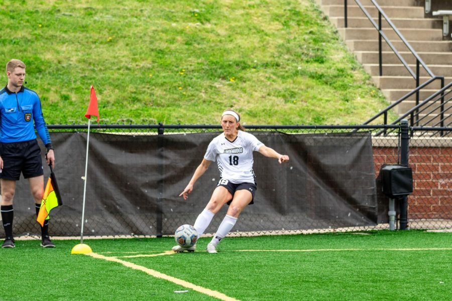 Women's soccer defender Alaina White fires in a corner during a home match vs. Lewis on April 16, 2021.