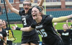 Erin McGuire (36) celebrates with teammates as women's lacrosse defeats No. 1 Indianapolis on May 16 at Hunter Stadium.