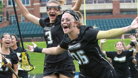 Erin McGuire (36) celebrates with teammates as women