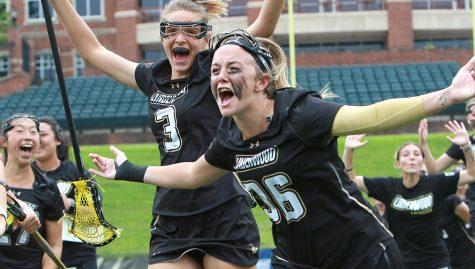 Erin McGuire (36) celebrates with teammates as women