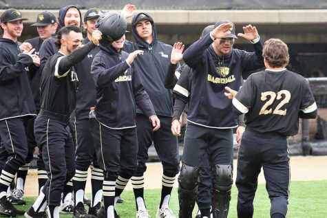 Kolby Schulte goes to celebrate with the rest of the team on May 28, 2021 against Davenport.