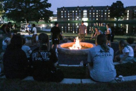 Students sit next to the new fire pit during New Student Orientation week for the 2021-22 school year.