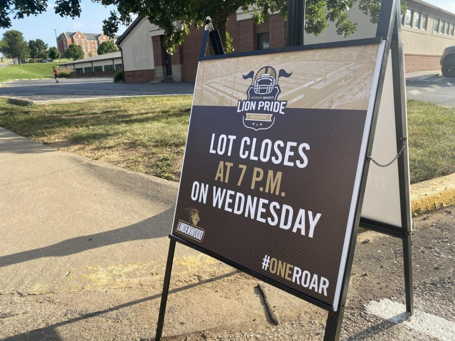 Outside of the Field House parking lot, signs have been placed to let students know that the lot will be closed by Wednesday night for the Lion Pride Tailgate. Photo taken on Tuesday, Aug. 31.
