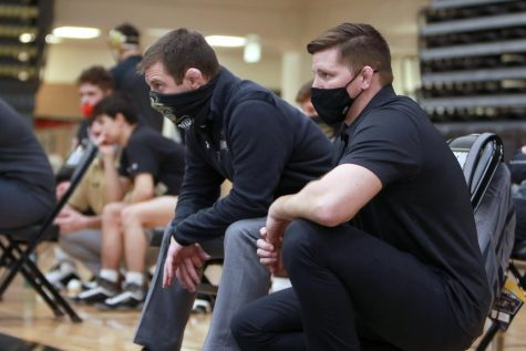 Jimmy Rollins (left) sits next to Dallas Smith (right) in a match vs. McKendree on Jan. 10.