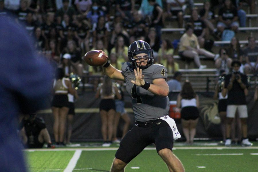 Senior+quarterback+Cade+Brister+looks+to+throw+it+out+to+a+receiver+in+the+2021+season+opener+against+Angelo+State+University+on+Thursday%2C+Sept.+3.