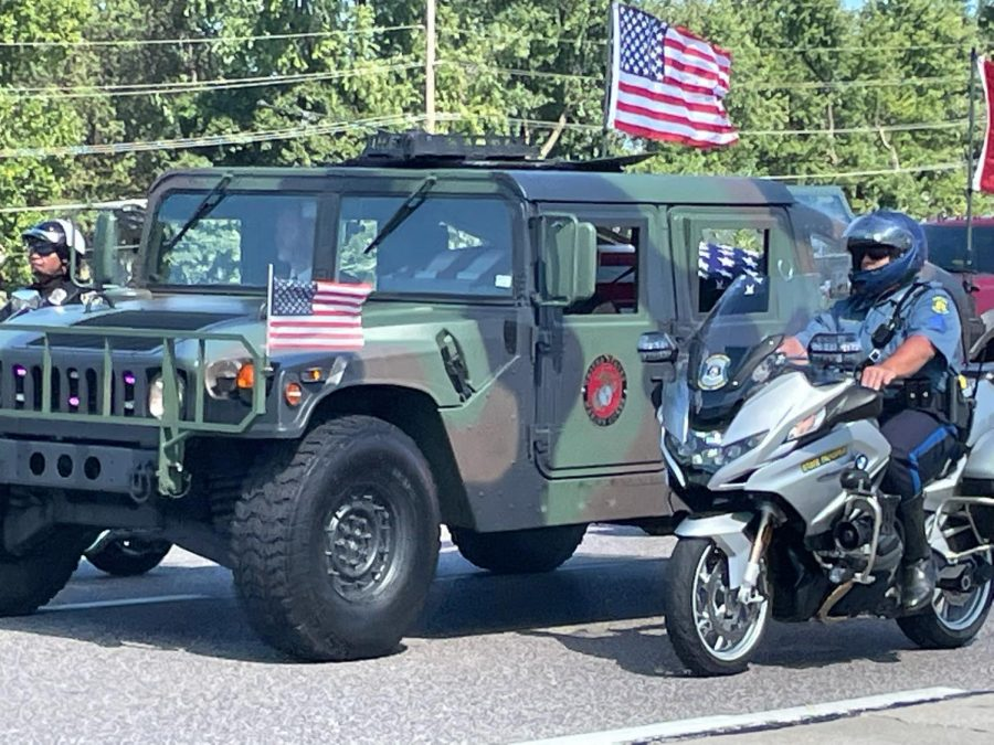 Schmitzs remains transported in a Humvee with escorts.