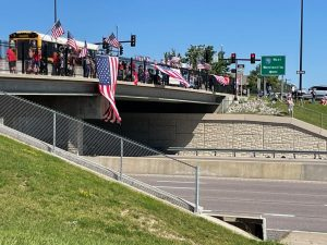 Saint Charles locals waiting for Schmitz's procession on the overpass near the Convention Center