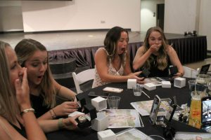 Meghan Rea (far left), Mikaela Summers (left), Sara Grieco (center), and Erin McGuire (right) react to seeing their rings for the first time.