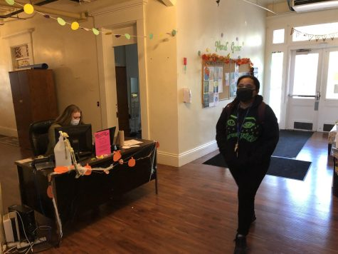 Student Agnes Adams (right) and Community Advisor Evie Sue Ward (left) wearing their masks in the hallway of Sibley Hall.